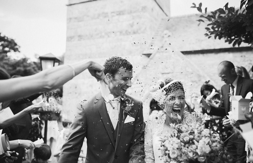 Fun confetti photo as bride and groom exit church