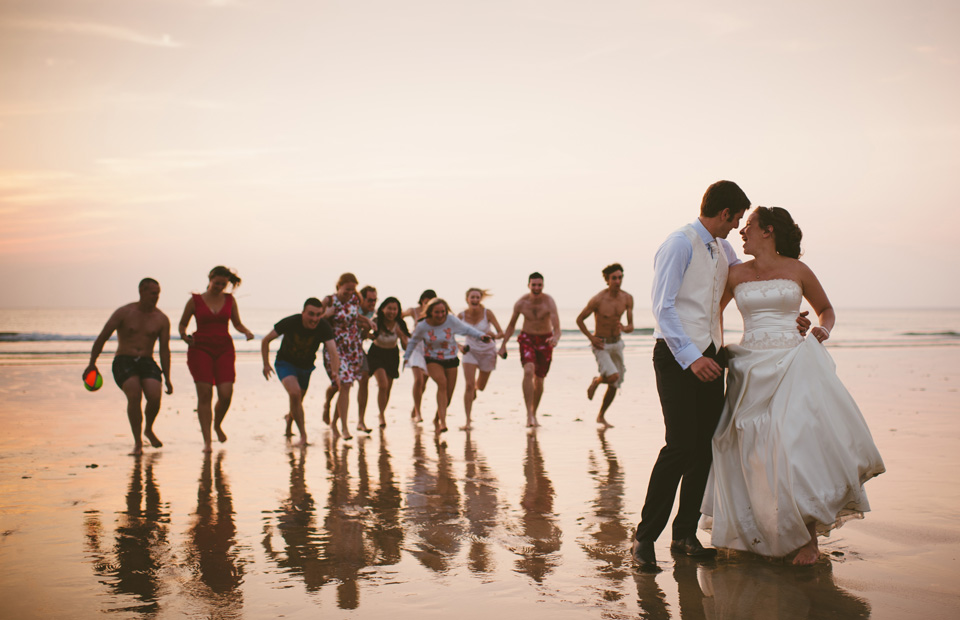 Sunset wedding photo at Lusty Glaze beach in Newquay