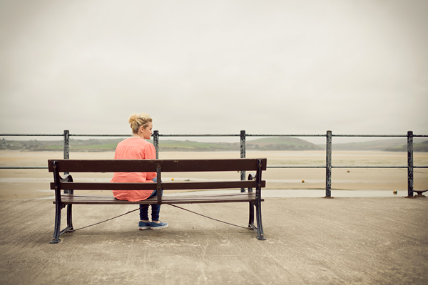 teenager sitting on a bench