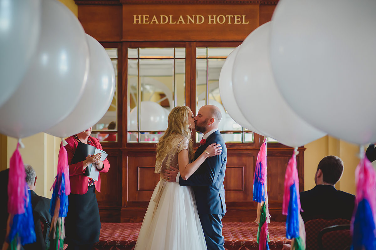 Headland Hotel wedding photos first kiss