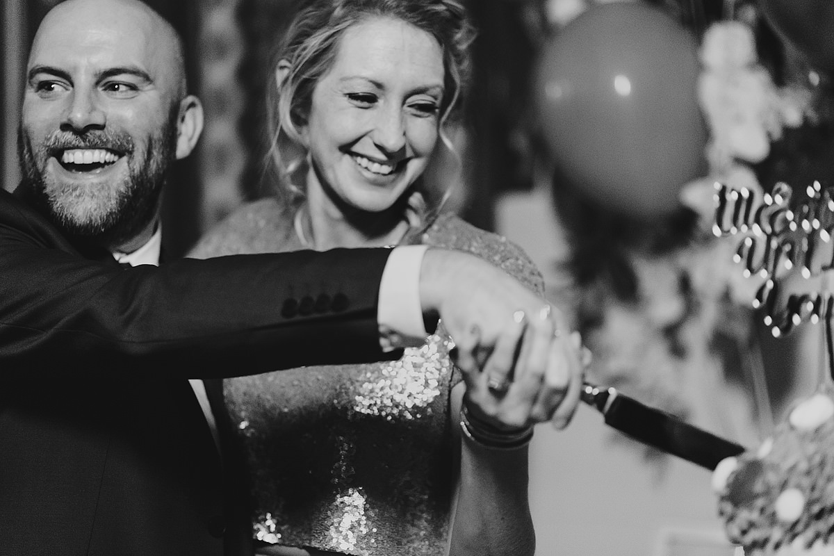 Bride and groom cutting the cake at a Headland Hotel wedding