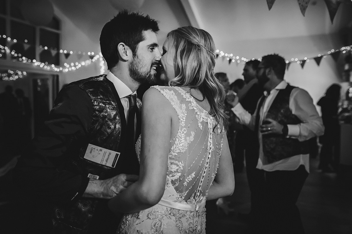 Bride and groom kissing on dance floor