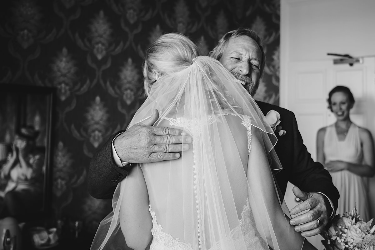 Father of the bride hug