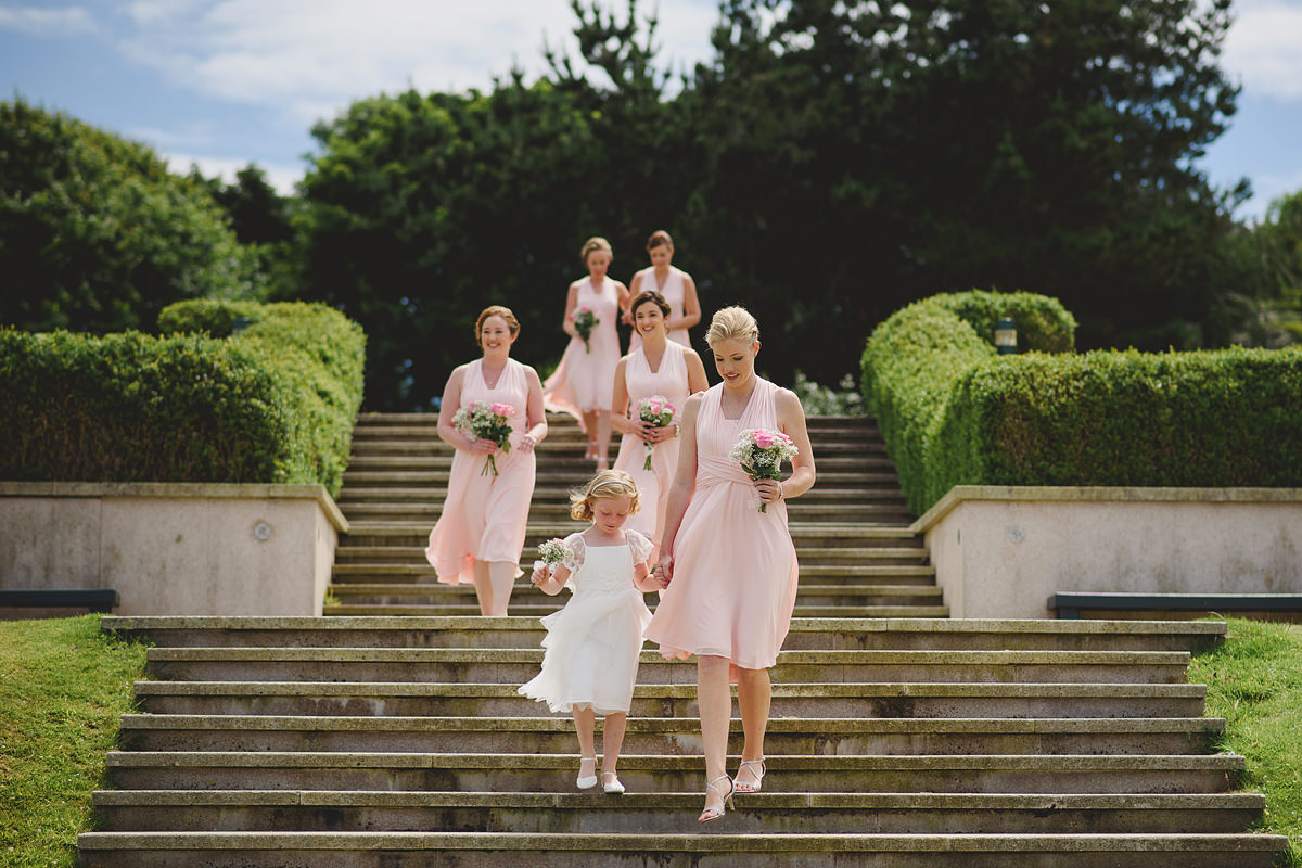 Bridesmaids walking down the isle