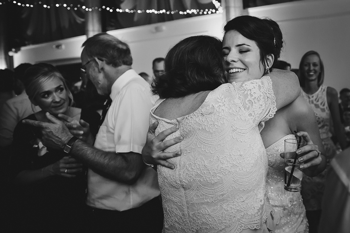 Bride and mum dancing