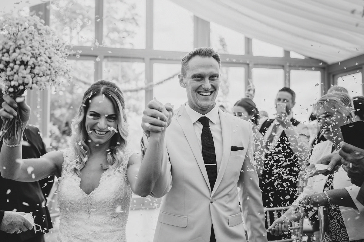 Bride and groom confetti moment