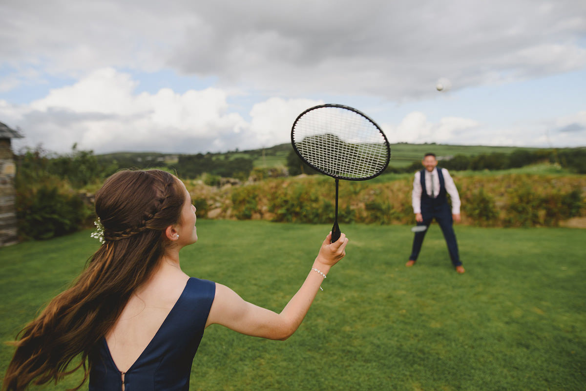 Playing tennis at a Trevenna Barns wedding